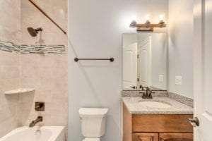 vanity and shower view in custom bathroom