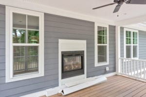 fireplace on back porch of custom home