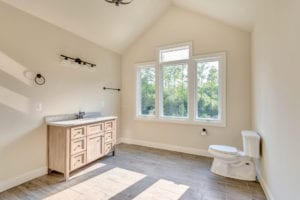 vanity and big windows in custom bathroom