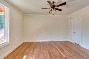 light fixture and wood floor in bedroom