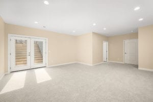 room with large doors in basement